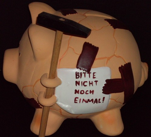 piggie bank with hammer